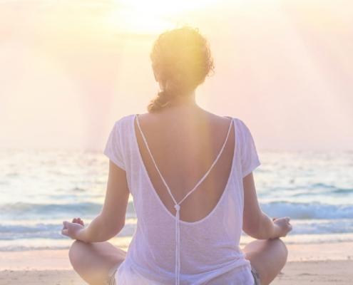 woman on beach - samsara healthy holidays